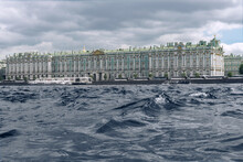 Waves On The Neva River Against The Background Of The Winter Palace In St. Petersburg