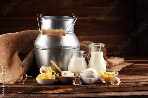 Fototapeta milk products. tasty healthy dairy products on a table on. mozzarella in a bowl, cottage cheese bowl, butter swirls, glass bottle obraz