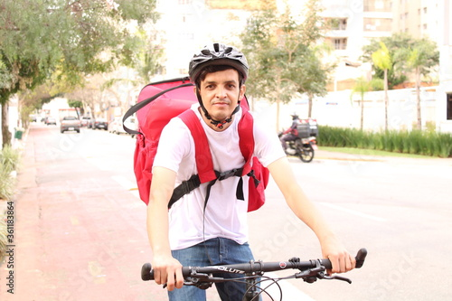 delivering food with the bike Fototapeta
