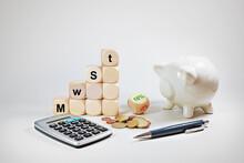 Calculator, Piggy Bank And Dic...