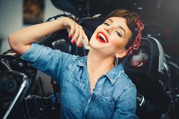 Fototapeta na wymiar beautiful woman posing near a motorcycle