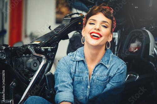 beautiful woman posing near a motorcycle