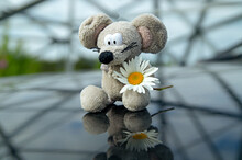 A Toy Mouse With A Flower In I...