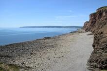Rocky Coastline Of Nova Scotia, Canada Under The Blue Sky
