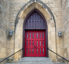 Old Stone Church With Red Doors