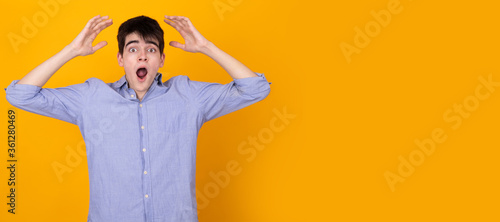 isolated teenager with expression of surprise and amazement in background with s Canvas Print