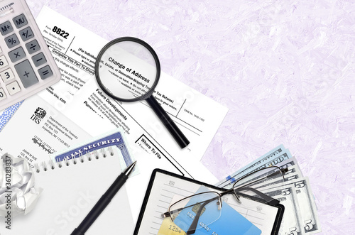 Photo IRS form 8822 Change of Address lies on flat lay office table and ready to fill