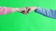 Leinwanddruck Bild - Team work concept Closeup of unknown two business people hands giving secret handshake fist bump.