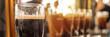 Leinwandbild Motiv Close up of a glass of stout beer in a bar