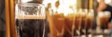 Fototapeta Kawa jest smaczna - Close up of a glass of stout beer in a bar