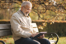 Handsome Elderly Man Sitting O...