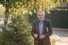 Handsome Senior Man Walk Throu...