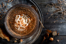 Beans - Lentils With Broth And Onions. Cooking Medieval English Dishes Of The 14th Century. Rustic Still Life On A Dark Background.