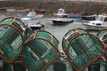 Closeup Shot Of Lobster Or Crab Basket Traps Stacked In A Harbor