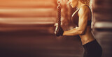 Muscular fitness woman doing exercises.  Cross fit bodybuilder  in the gym