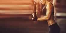 Muscular Fitness Woman Doing E...