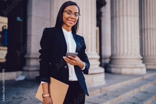 Fényképezés Portrait of successful African American businesswoman dressed in stylish suit ho