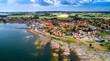 canvas print picture - Panorama der dänischen Stadt Svaneke auf der Insel Bornholm an einem Sommertag mit Blick auf die Granitfelsen und Häuser mit roten Dächern.