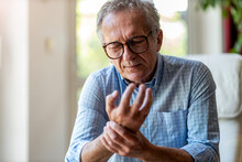 Senior Man With Arthritis Rubb...
