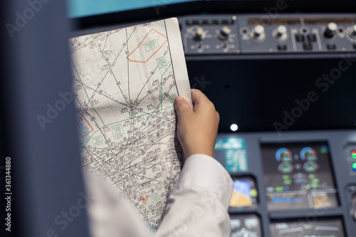 Young pilot in the aircraft in front of the dashboard Fototapeta