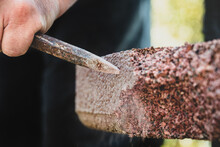 Close-up Of A Man Cutting Stone With A Chisel