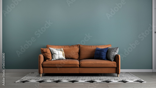 Fotografia, Obraz Mock up living room interior background, green room with brown sofa furniture,