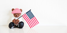 One Teddy Bear In A Red Stripe...