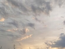 Beautiful Dramatic Sunset. The Sky Turned Yellow. Dark Gray Clouds. Clouds Lit By The Lateral Evening Sun. Soft Warm Tones And Colors. Summertime Atmosphere