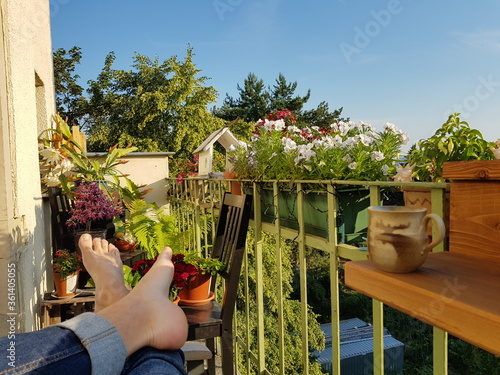 Valokuva Relaxing on a blooming balcony in summer