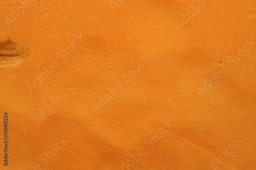 Slightly deformed orange foam piece surface Fototapet