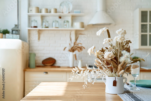 Obraz Kitchen wooden table top and kitchen blur background interior style scandinavian - fototapety do salonu