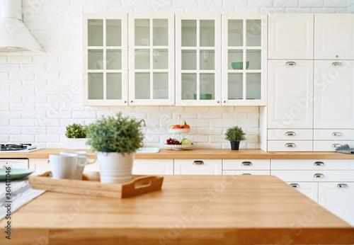 Cuadros en Lienzo Kitchen wooden table top and kitchen blur background interior style scandinavian