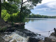 A Little Waterfall Running Off The Lake At Belmont Lake State Park In West Babylon, Long Island NY