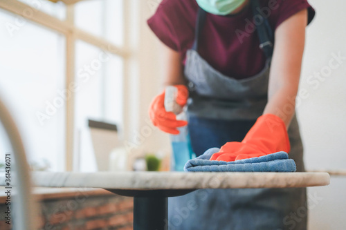 Fotomural cafe owner cleaning table before open in covid 19 situation