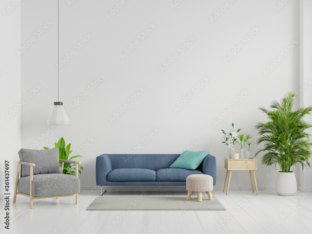 Blue Sofa and gray armchair in spacious living room interior with plants and shelves near wooden table.