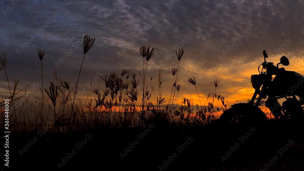 Fototapeta Motorcycle silhouette at sunset time