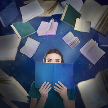 Young Woman Reading And Flying Books On Color Background