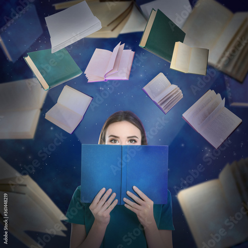 Valokuva Young woman reading and flying books on color background