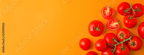 Fototapeta Flat lay composition with fresh cherry tomatoes on color background, space for text. Banner design obraz