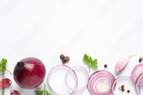 Foto Flat lay composition with cut onion and spices on white background
