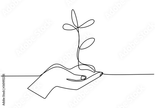 Hand holding plant's pot Wallpaper Mural