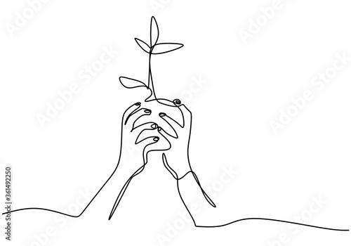 Hand holding plant's pot Canvas