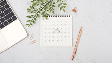 Calendar With Rose Gold Pen On White Table