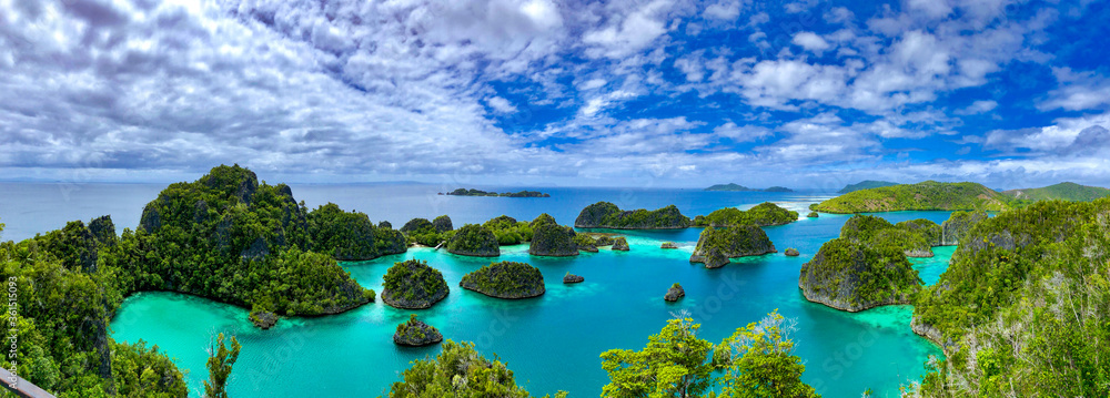 Fototapeta A beautiful lagoon is surrounded by limestone islands in Raja Ampat, West Papua, Indonesia.