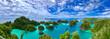 Leinwandbild Motiv A beautiful lagoon is surrounded by limestone islands in Raja Ampat, West Papua, Indonesia.