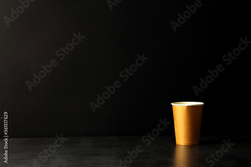 brown corrugated paper coffee cup on black background Wallpaper Mural