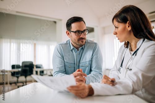 Fototapeta Medical consultations. Attentive positive man listening to a female doctor. obraz