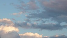 Gray-blue And Pink Clouds Float Through The Sky At Sunset, Time Lapse