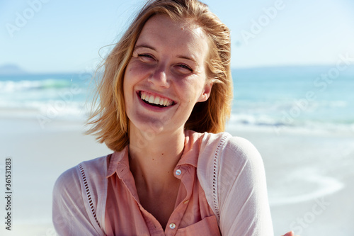 Portrait of woman smiling on the beach