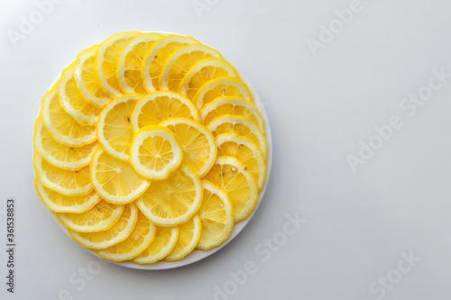 Lemon cut into slices on a white plate Wallpaper Mural